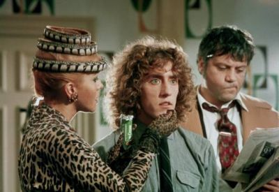 """Ann-Margret, Roger Daltrey e Oliver Reed no filme """"Tommy"""""""